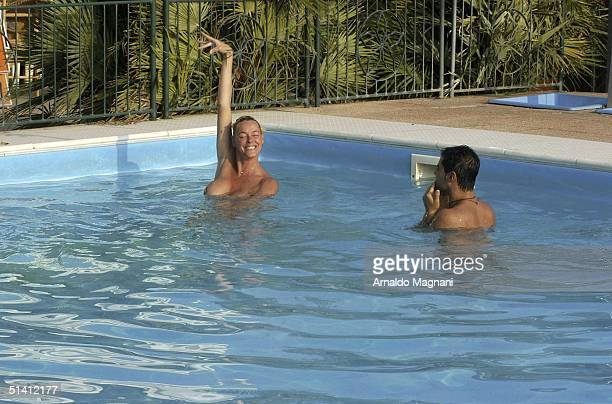 Actress Brigitte Nielsen is seen swimming naked with her fiance Mattia Dessi at a public pool on August 12 2004 in Milano Marittima Italy