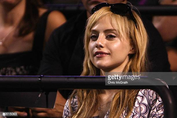 Actress Britney Murphy watches as Roger Federer of Switzerland plays a match against Andy Roddick during day eleven of the Sony Ericsson Open at the...