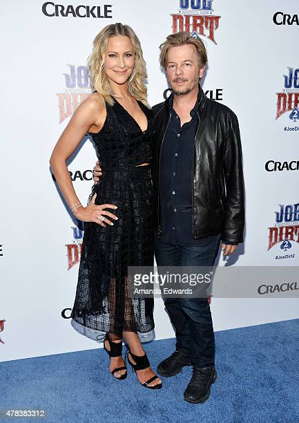 Actress Brittany Daniel and actor David Spade arrive at the world premiere of Joe Dirt 2 Beautiful Loser hosted by Crackle at Sony Studios on June 24...