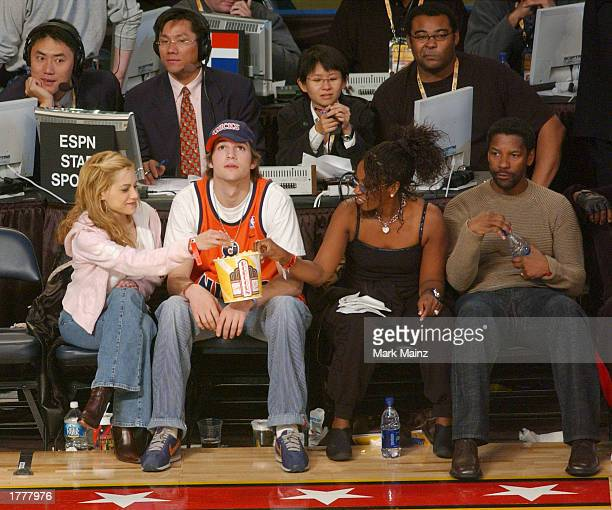 Actress Brittany Murphy actor Ashton Kutcher Pauletta Washington and actor Denzel Washington watch the action during the 2003 NBA AllStar game at the...