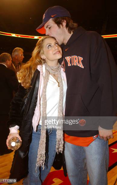 Actress Brittany Murphy and actor Ashton Kutcher during the 2003 NBA All-Star game at the Phillips Arena February 9, 2003 in Atlanta, Georgia.