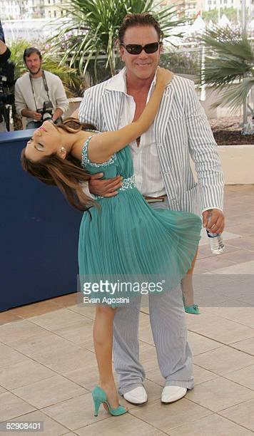Actress Brittany Murphy and actors Mickey Rourke attend a photocall promoting the film Sin City at the Palais during the 58th International Cannes...