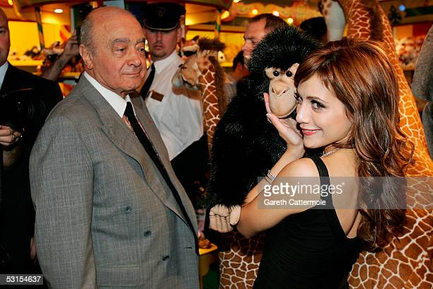 Actress Brittany Murphy and Harrods owner Mohamed Al Fayed are seen in the toy department as they launch the London department store Harrods Summer...