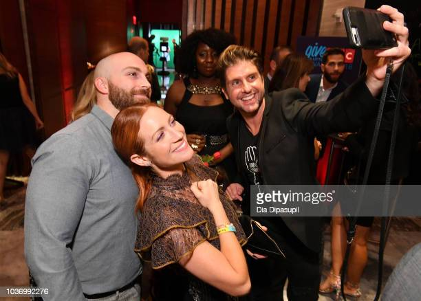 Actress Brittany Snow and guests pose for a selfie during 2018 TLC's Give A Little Awards on September 20 2018 at Park Hyatt in New York City