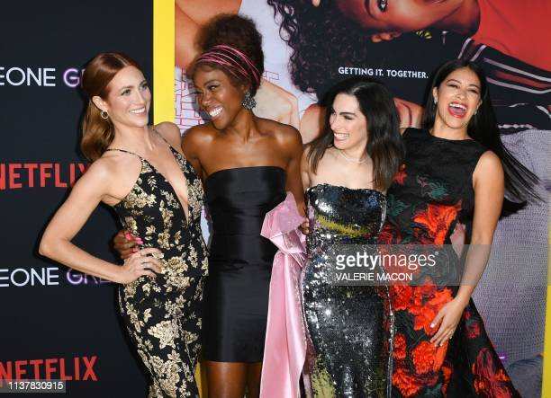 Actress Brittany Snow DeWanda Wise writer/director Jennifer Kaytin Robinson and actress Gina Rodriguez arrive for the Netflix's premiere of Someone...