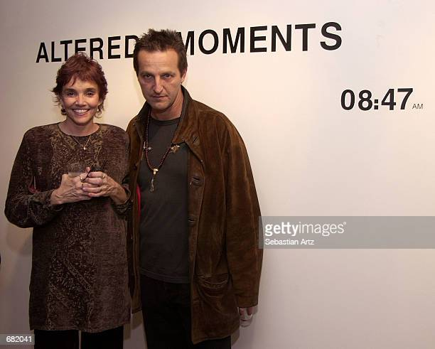 Actress Brooke Adams and photographer Luca Babini pose at the opening of Babini's photo exhibition Altered Moments November 16 2001 in Santa Monica...