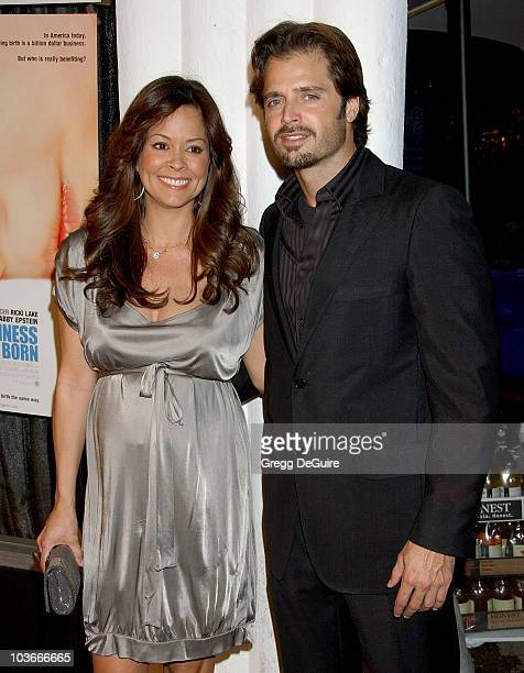 """Actress Brooke Burke and actor David Charvet arrive at the Los Angeles premiere of """"The Business of Being Born"""" at the Fine Arts Theatre on January..."""