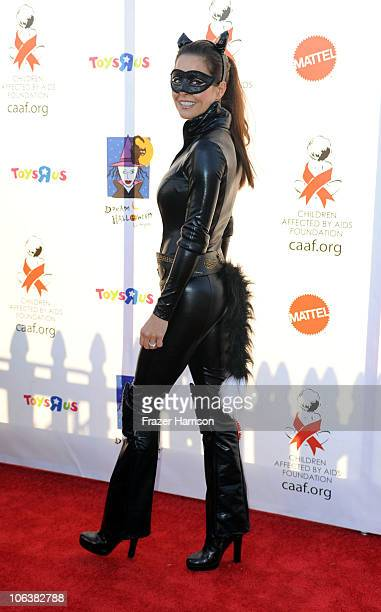Actress Brooke Burke arrives at the Children Affected By AIDS Foundation's 17th Annual Dream Halloween event at Barker Hanger on October 30 2010 in...