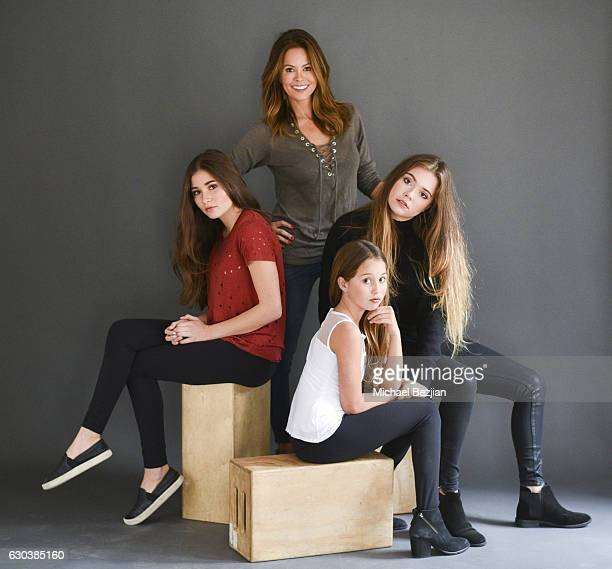 Actress Brooke Burke poses for portrait with her daughters Sierra Rain and Neriah at Brooke Burke Visits The Artists Project on December 21 2016 in...
