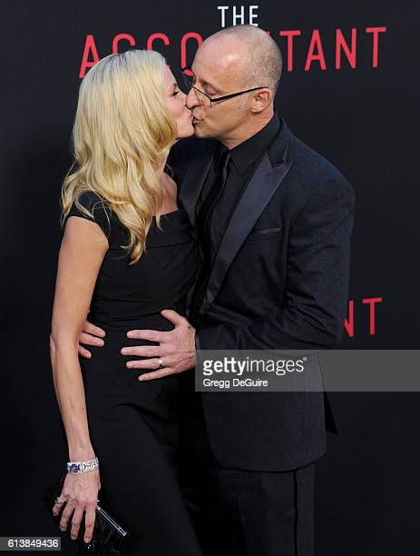 """Actress Brooke Burns and director Gavin O' Connor arrive at the premiere of Warner Bros Pictures' """"The Accountant"""" at TCL Chinese Theatre on October..."""