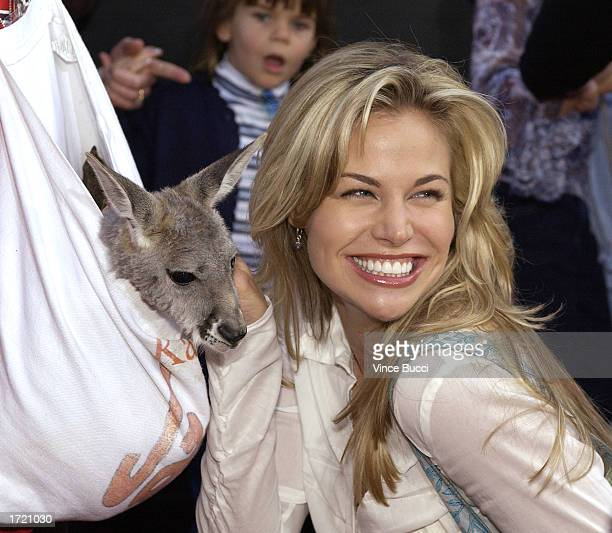 Actress Brooke Burns poses with a baby kangaroo at the premiere of the film Kangaroo Jack at Grauman's Chinese Theatre on January 11 2003 in...
