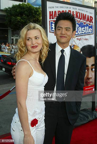 Actress Brooke D'Orsay and actor John Cho arrive at the World Premiere of Harold Kumar Go to White Castle at the Grauman's Chinese Theatre on July 27...