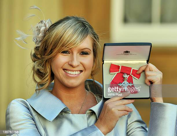 Actress Brooke Kinsella holds her MBE after it was presented to her by Prince Charles Prince of Wales during an Investiture Ceremony at Buckingham...