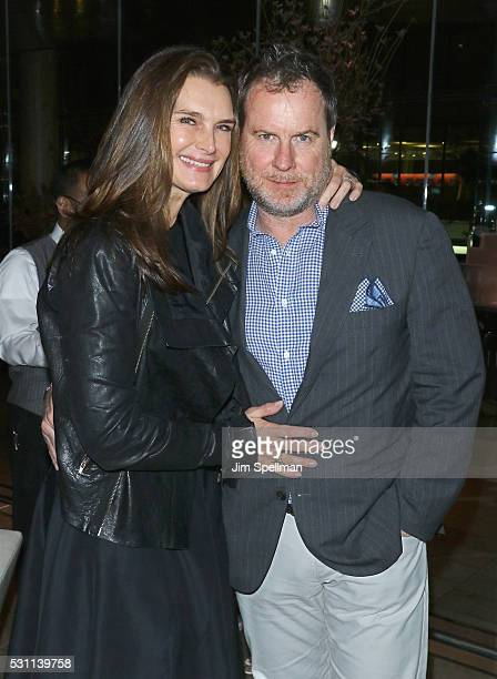Actress Brooke Shields and Chris Henchy attend the reception for the New York premiere of EPIX's Under The Gun at Lincoln on May 12 2016 in New York...