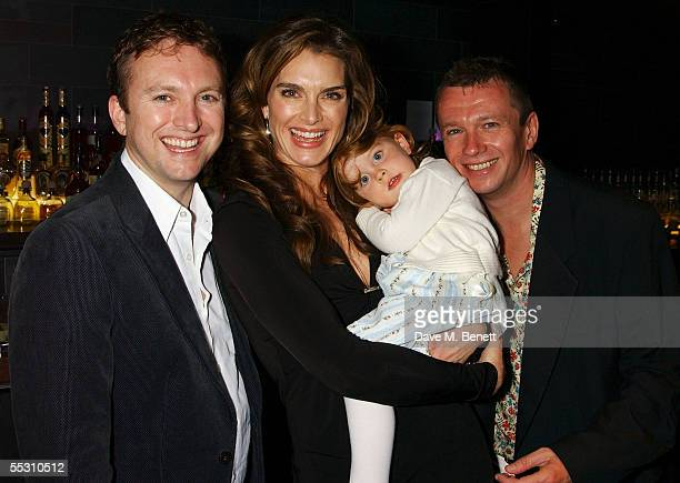 Actress Brooke Shields and daughter Rowan pose with guests during Shields's 40th birthday celebration at the Mint Leaf restaurant in London's...