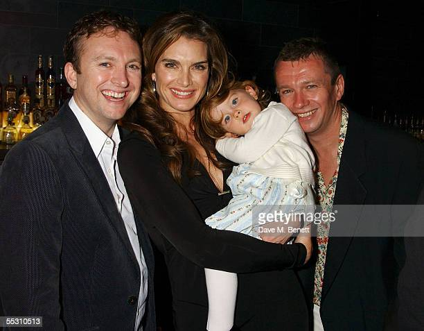 Actress Brooke Shields and her daughter Rowan pose with guests during Shields's 40th birthday celebration at the Mint Leaf restaurant in London's...