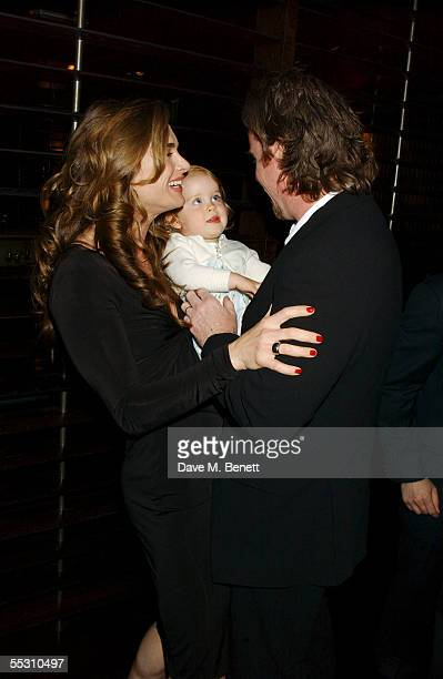 Actress Brooke Shields and her husband, writer Chris Henchy, share a moment with their daughter Rowan during Shields's 40th birthday celebration at...