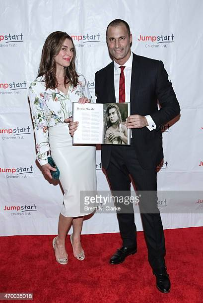 Actress Brooke Shields and photographer Nigel Barker pose with Mr Barker's newest book durng the Scribbles To Novels 10th Anniversary Gala held at...
