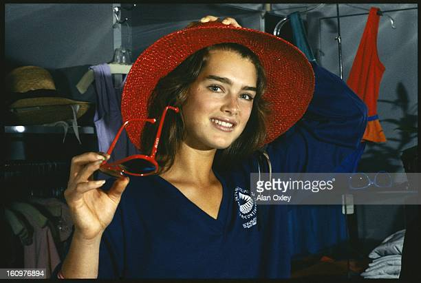 Actress Brooke Shields at age 18 tries on a hat in a gift store while on a Florida vacation in July 1983