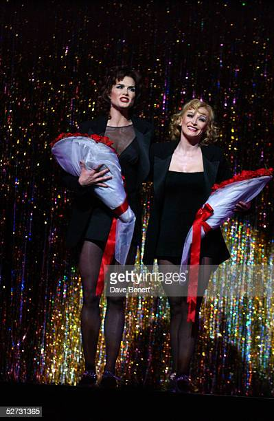 Actress Brooke Shields holds a bouquet of roses as she appears on stage for her first night playing Roxie Hart with actress Anna Montanaro in the...