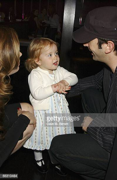 Actress Brooke Shields looks on as her daughter Rowan talks to actor David Schwimmer during Shields's 40th birthday celebration at the Mint Leaf...