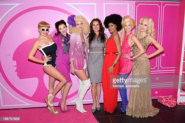 Actress Brooke Shields poses with models during Barbie The Dream Closet Playdate Saturday February 11th at David Rubenstein Atrium on February 11...