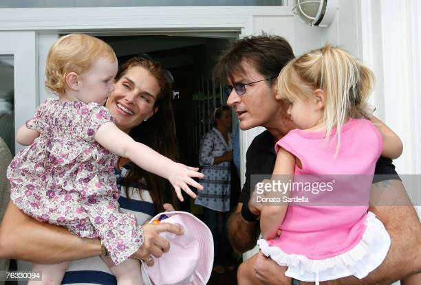 MALIBU CA AUGUST 25 Actress Brooke Shields with daughter Grier Henchy and Actor Charlie Sheen with daughter Sam Sheen attend the French Connection's...