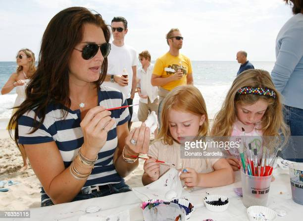 MALIBU CA AUGUST 25 Actress Brooke Shields with daughter Rowan Henchy and friend attend the French Connection's Kids connection to benefit The Art Of...