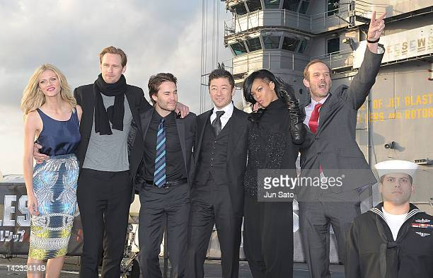 Actress Brooklyn Decker actors Alexander Skarsgard Taylor Kitsch Tadanobu Asano actress Rihanna and director Peter Burg attend the 'Battleship' Press...