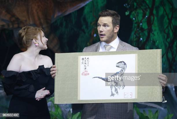 Actress Bryce Dallas Howard and actor Chris Pratt attend 'Jurassic World Fallen Kingdom' press conference at 1933 Old Millfun on May 30 2018 in...