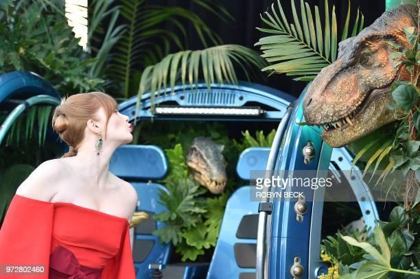 US actress Bryce Dallas Howard blows a kiss toward a dinosaur during the premiere of Jurassic World Fallen Kingdom on June 12 2018 at The Walt Disney...