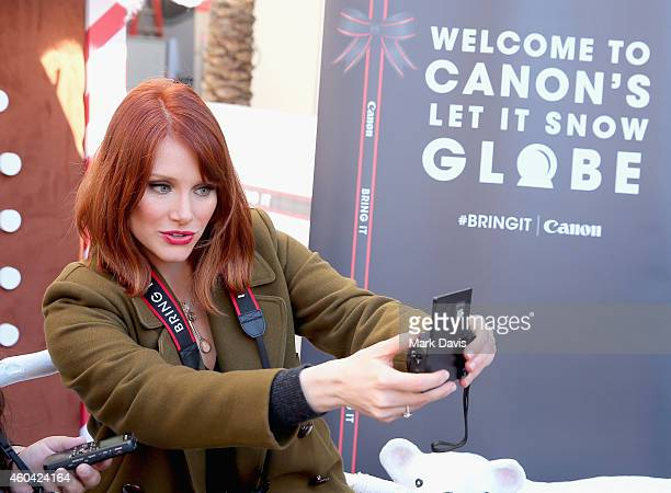 """Actress Bryce Dallas Howard hosts the Canon """"Let It Snow"""" Globe spectacle at Hollywood Highland on December 13 2014 in Hollywood California"""