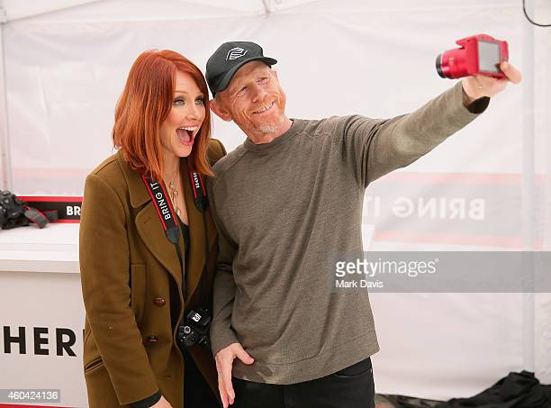 "Actress Bryce Dallas Howard with filmmaker Ron Howard hosts the Canon ""Let It Snow"" Globe spectacle at Hollywood Highland on December 13 2014 in..."