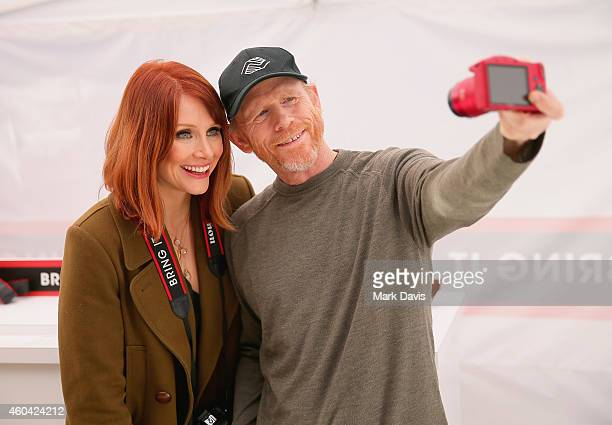 """Actress Bryce Dallas Howard, with filmmaker Ron Howard, hosts the Canon """"Let It Snow"""" Globe spectacle at Hollywood & Highland on December 13, 2014 in..."""
