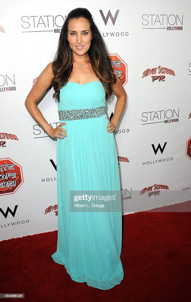 Actress Burgandi Phoenix arrives at W Hotel Station Club's Annual Emmy Party held at W Hollywood on August 23, 2014 in Hollywood, California.