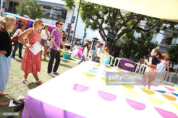 Actress Busy Philipps and her daugthers Birdie Silverstein and Cricket Silverstein attends Yoobi Fun Day at The Grove on July 31 2014 in Los Angeles...