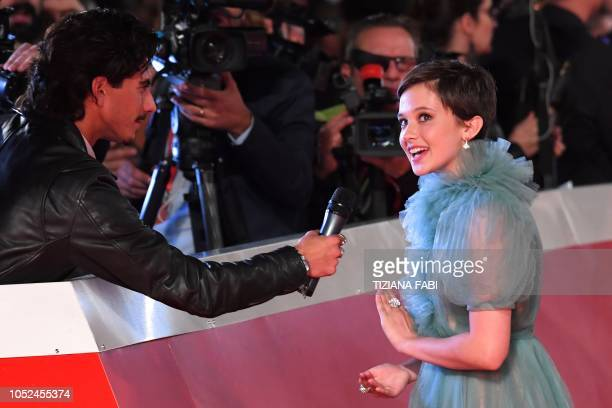 US actress Cailee Spaeny answers a reporter as she arrives for the screening of the film Bad Times at the El Royale during the opening of the 2018...