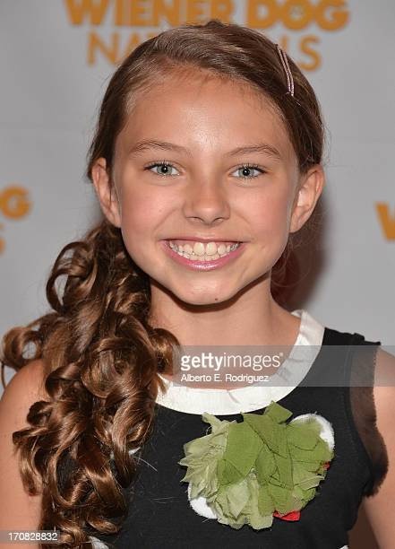 Actress Caitlin Carmichael arrive to the Premiere of Wiener Dog Nationals at Pacific Theatre at The Grove on June 18 2013 in Los Angeles California
