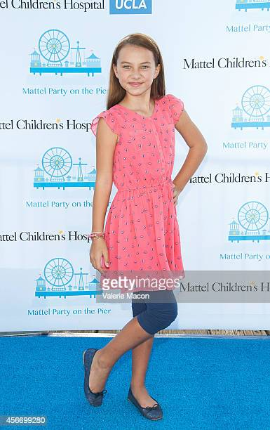 Actress Caitlin Carmichael arrives at the 15th Annual Party On The Pier Hosted By Sarah Michelle Gellar at Santa Monica Pier on October 5 2014 in...