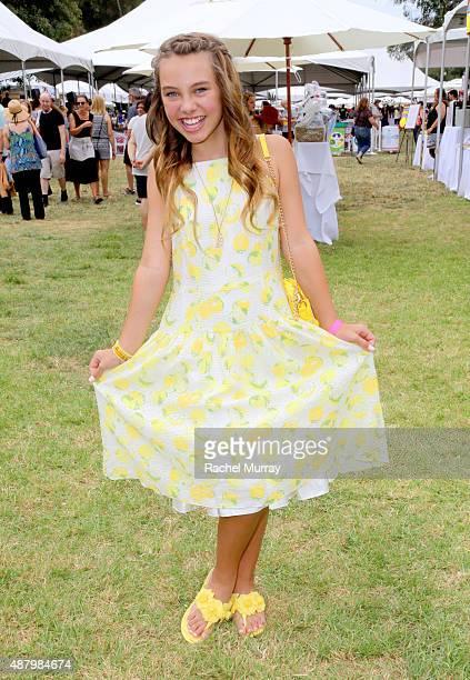 Actress Caitlin Carmichael attends LA Loves Alex's Lemonade on September 12 2015 in Los Angeles California