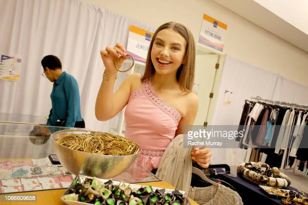 Actress Caitlin Carmichael shops during Shop for Success Dress for Success West Coast fundraiser on November 29 2018 in Los Angeles California