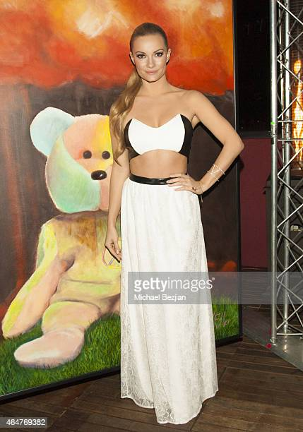 Actress Caitlin O'Connor attends Caroline Burt DJs At Victoria Fuller's The Beauty Code Art Show at The Redbury Hotel on February 25 2015 in...