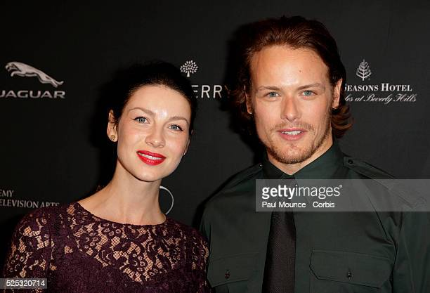 Actress Caitriona Balfe and actor Sam Heughan arrive at the British Academy of Film and Television Arts 2014 Awards Season Tea Party held at the Four...