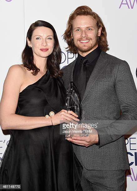 Actress Caitriona Balfe and actor Sam Heughan pose in the press room at The 41st Annual People's Choice Awards at Nokia Theatre LA Live on January 7...