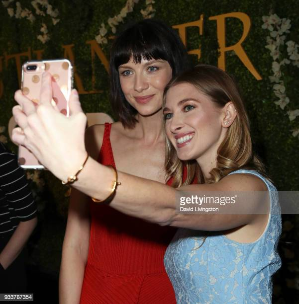 Actress Caitriona Balfe and TV correspondent Leanne Aguilera pose for a selfie at the For Your Consideration event for STARZ's 'Outlander' at the...