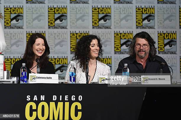 """Actress Caitriona Balfe, producer Maril Davis and writer/producer Ronald D. Moore attend the Starz: """"Outlander"""" panel during Comic-Con International..."""