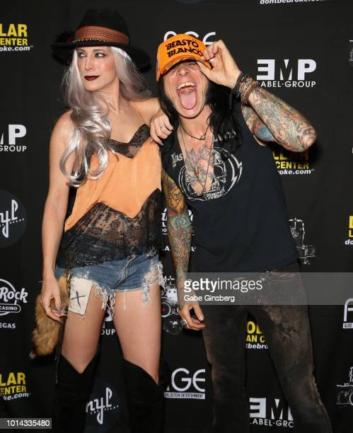 Actress Calico Cooper and bassist Chuck Garric of Alice Cooper attend a CD release party for COOP at Vinyl inside the Hard Rock Hotel Casino on...