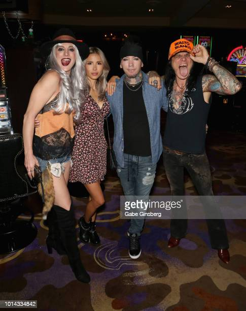 Actress Calico Cooper model Nathalia Ashba guitarist Dj Ashba of Sixx AM and bassist Chuck Garric of Alice Cooper attend a CD release party for COOP...