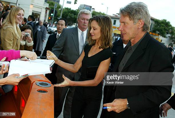 Actress Calista Flockhart and actor Harrison Ford sign autographs for fans at the arrivals for the premiere of Columbia Pictures'/Revolution Studios'...