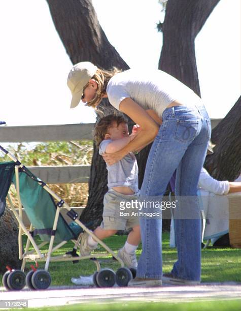 Actress Calista Flockhart and her son Liam spend time in the park on July 24 2002 in Santa Monica California